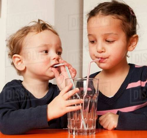 How does the water or juice move upwards through the straw while drinking?